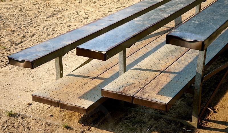 grey rectangular shape metal framed bench photo