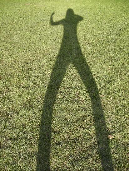 shadow grass fist punch selfie photo