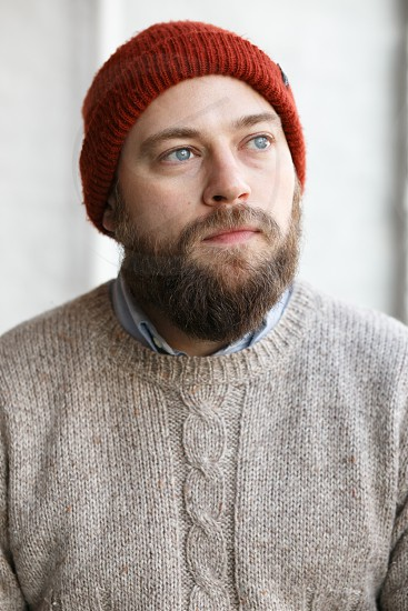 men's grey knitted sweater  photo