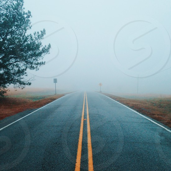 Road travel fog unknown lines photo