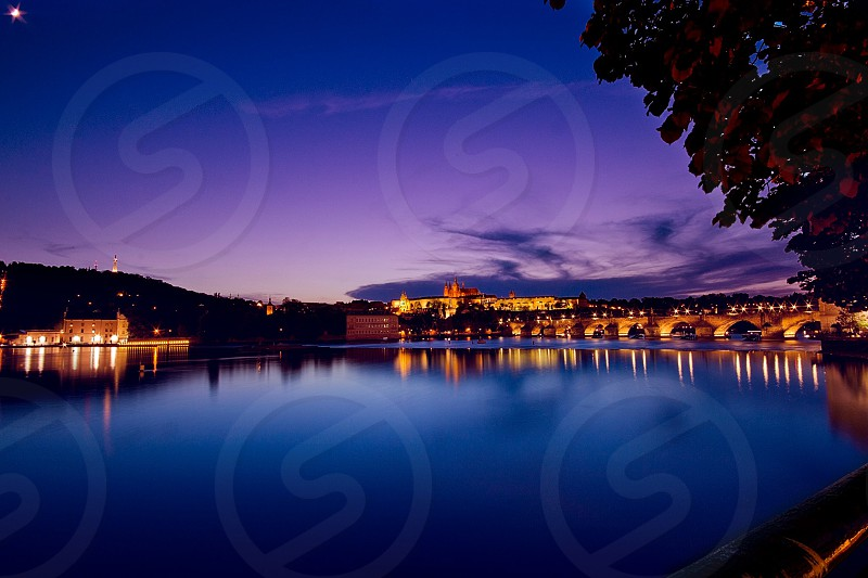 The St Charles Bridge and Prague castle in the twilight.  photo