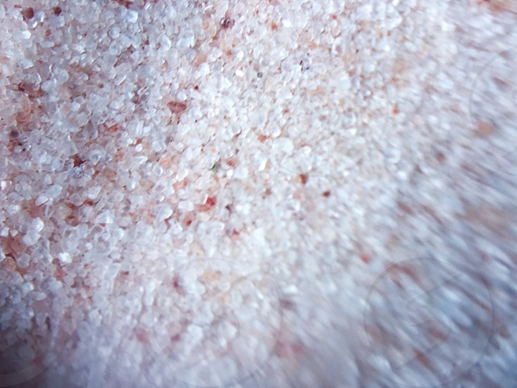 Pink salt sea salt texture healthy salty seasoning cooking recipe movement pour spices herbs chef Himalayan salt course photo