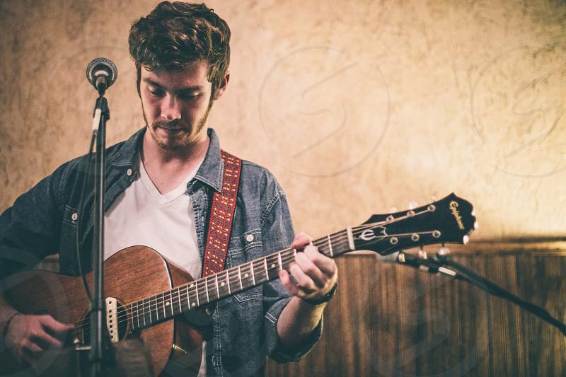performance musician guitar photo