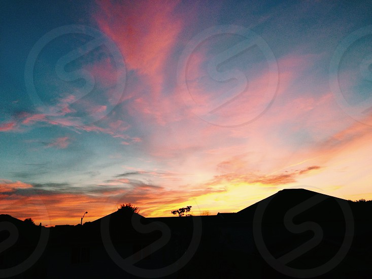 early morning sky clouds yellow pink blue orange southern ontario canada beautiful house top photo
