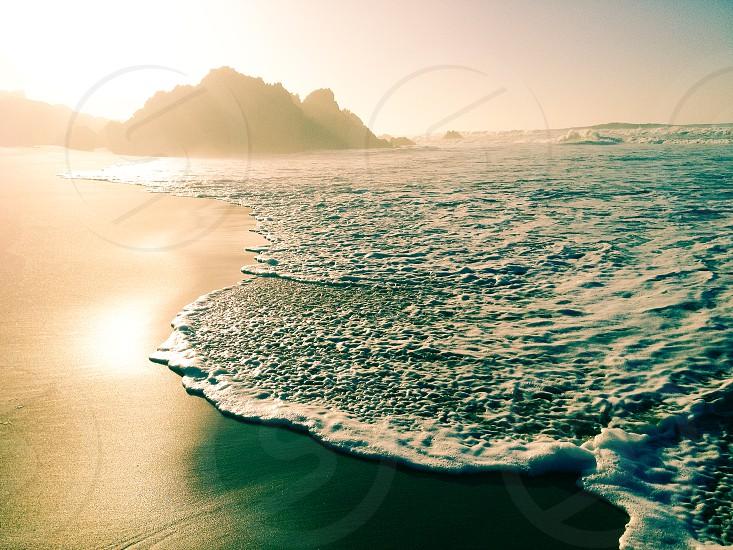 Golden beach sunrise photo