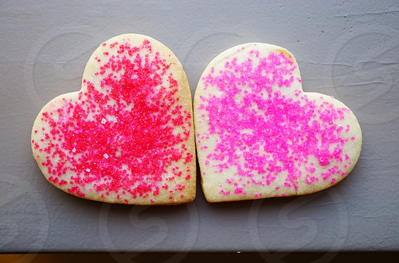 Heart shaped red and pink sugar cookies photo