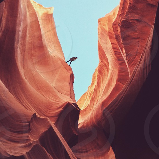 person on brown sandy mountain photo