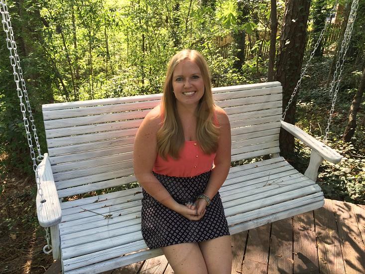porch swing blonde woman photo