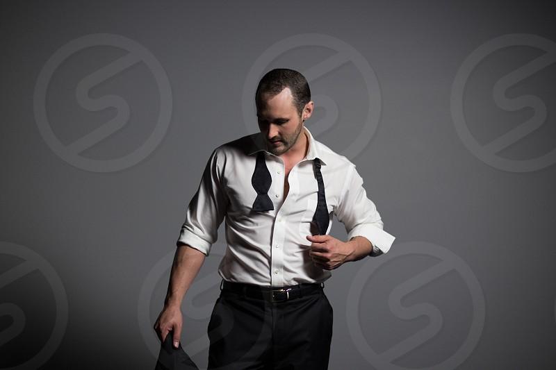 man wearing white dress shirt and black necktie photo