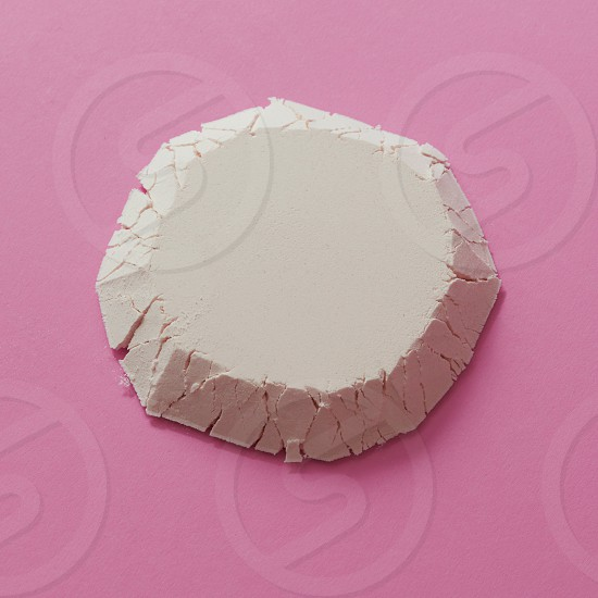 Geometric figure of flour in the form of a circle isolated on a pink background flat lay photo