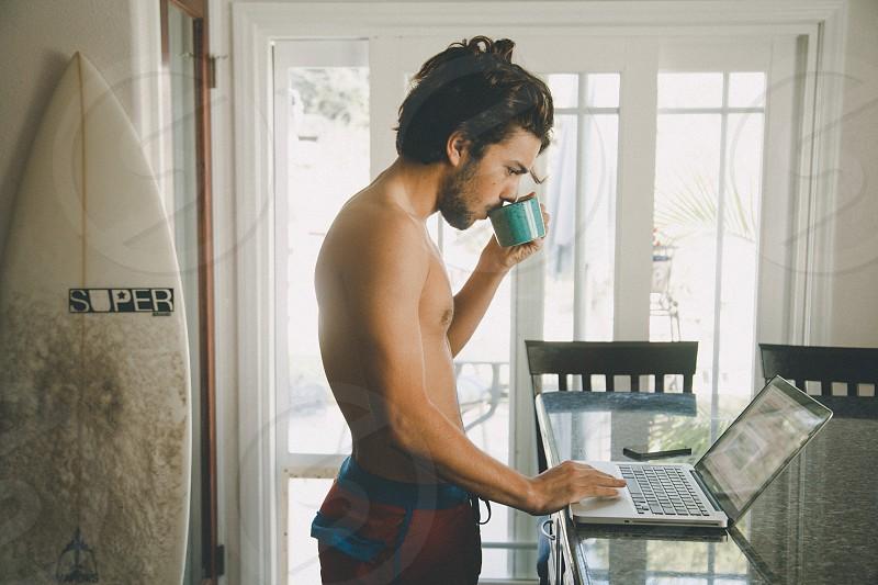 man using grey laptop photo