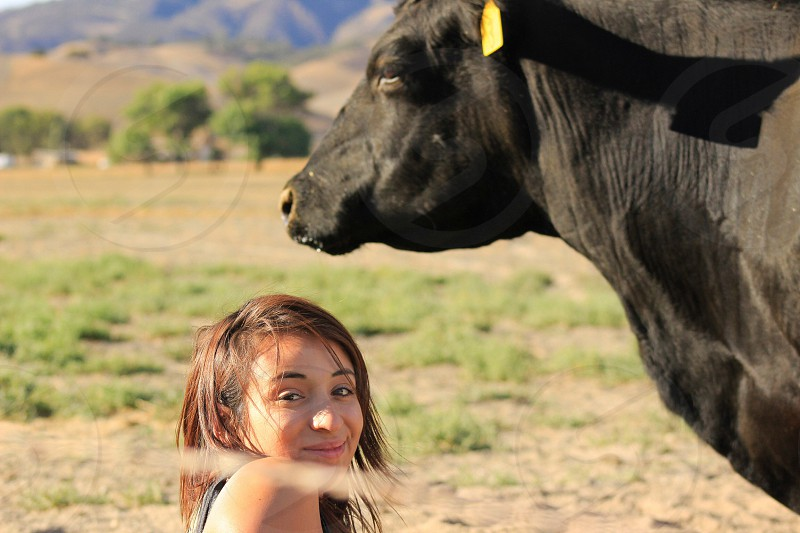Cow girl 1st time meeting cow photo