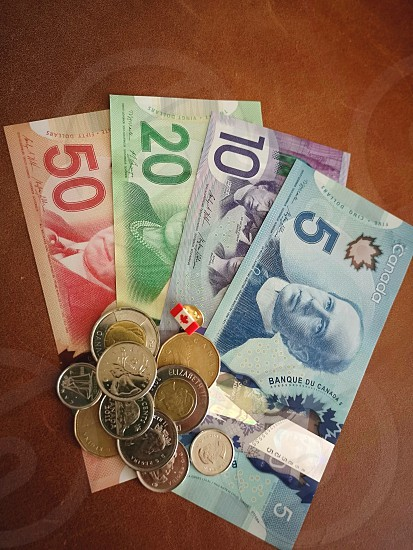 Canadian bills and coins with Canada pin photo