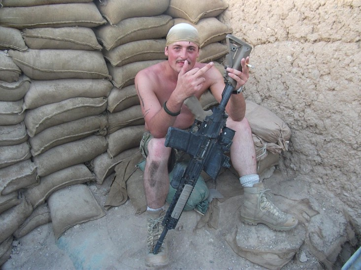 A British Commando relaxing in Afghanistan-Helmand Province photo