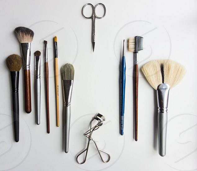 Makeup brushes eyelash curler hair trimmer photo