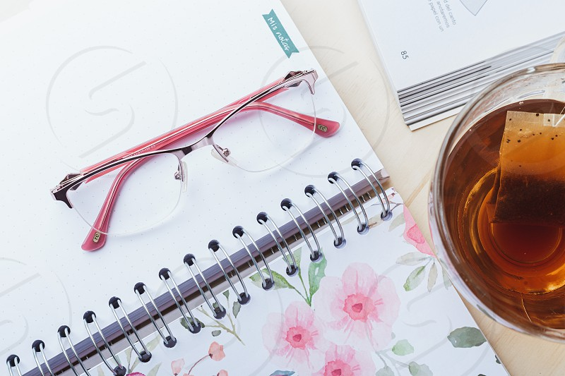 Woman glasses with tea and books photo