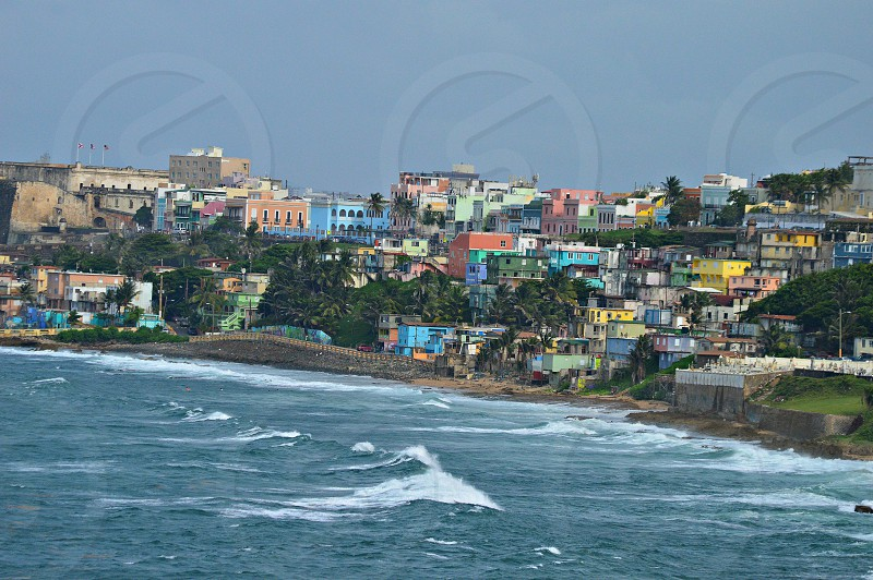 The mountainside of San Juan Puerto Rico. The amazing colors of the buildings from the ocean are breathtaking. photo