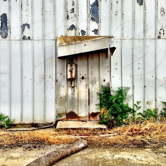 Old building abandoned falling awning doorway  photo