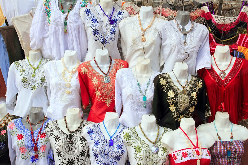 Mayan Mexico embroided traditional dresses retail shop photo
