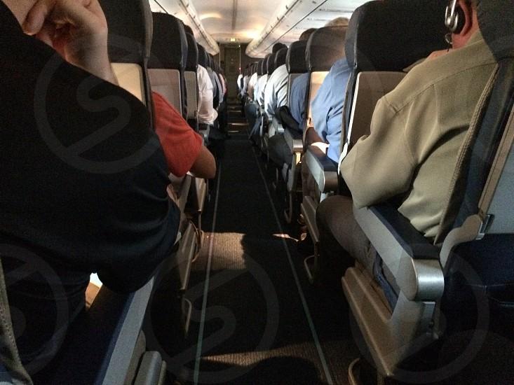 people sitting on passenger airplane photo