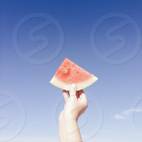 Vibrant watermelon hand beach food summer blue fruit sweet photo