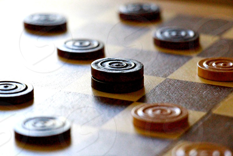 brown and black chess piece on chess board photo