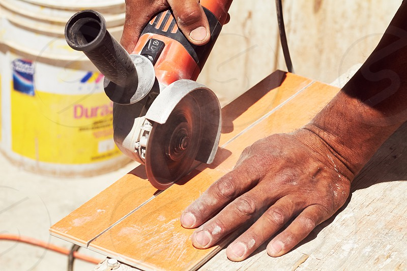 CONSTRUCTION TILE HANDS WORKER photo