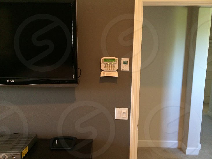 room with black sharp flat screen television on gray wall photo