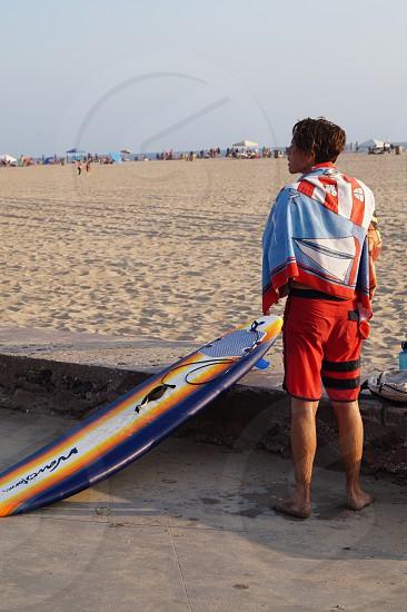 Beach surfing surfer surfboard fun summertime ocean photo
