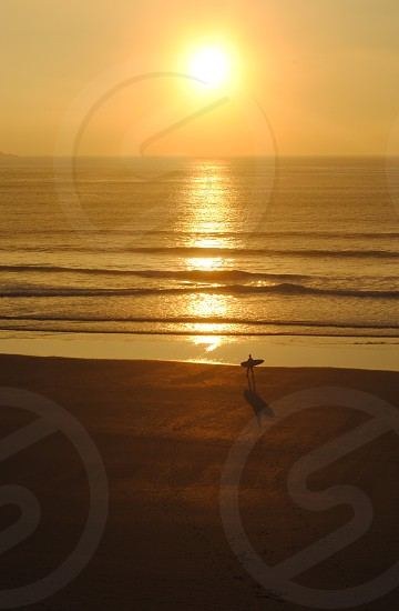 A surfer at St Davids Wales photo