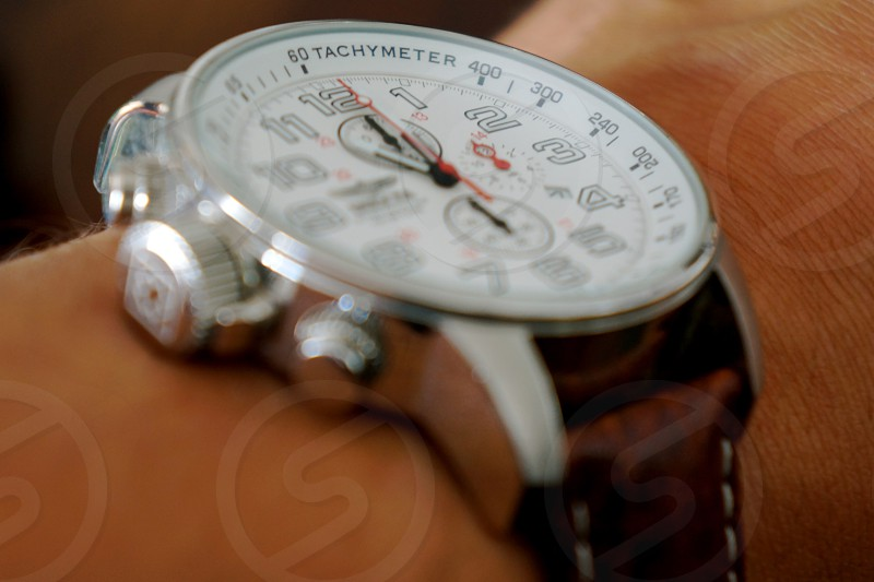 brown white and silver chronograph wristwatch photo