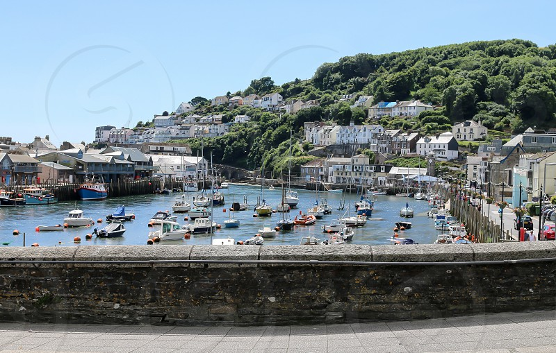 The view over Looe harbour on a sunny day with the boats moored up after a hard nights fishing photo
