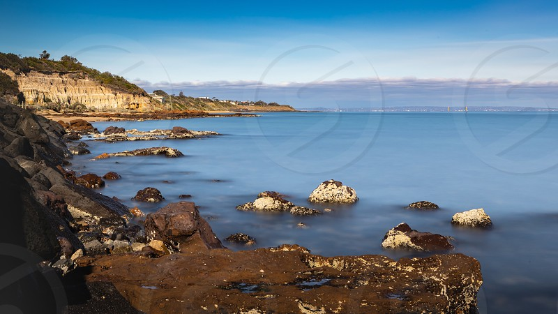 Long exposure Lee filters ND filter rocks water coast coastal coastline sky blue sky cloud streaks local Black Rock suburb Melbourne Victoria Australia bay Port Phillip Bay waterway Ian Jones Photography blue water vista landscape photo