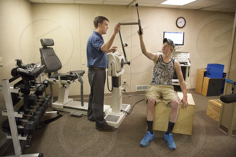 A physical therapist runs a series of tests required by the patient's employer. photo