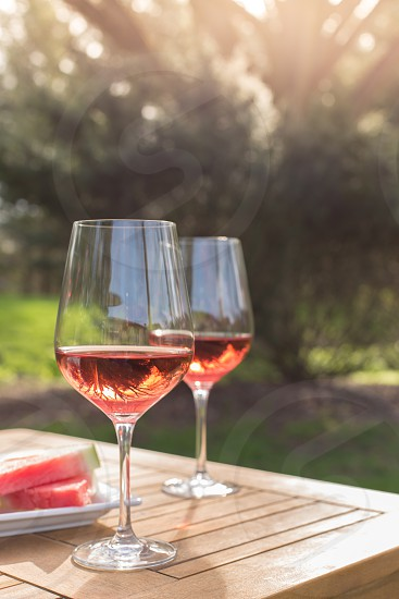 Glasses of rose wine and watermelon on a summer day photo