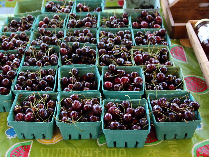 Black cherries in cartons at farmers market photo