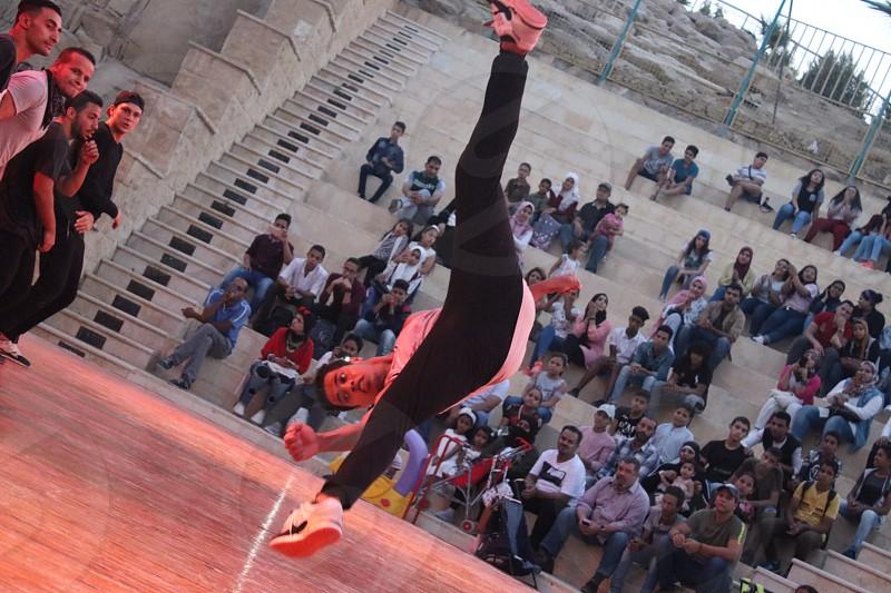 Dancing jumping performing outdoor photo