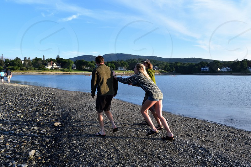 Friends having fun in Bar Harbor  in Maine. photo