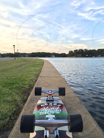 Longboarding by the river  photo