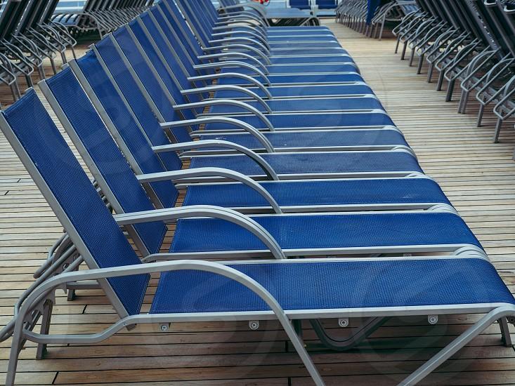 Bright blue empty beach chairs  photo