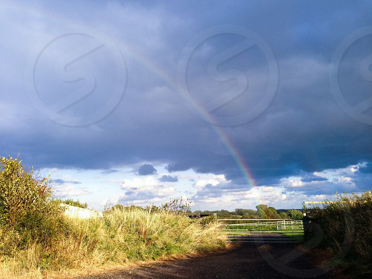 Stormy skies (with a rainbow) in Branscombe Devon photo