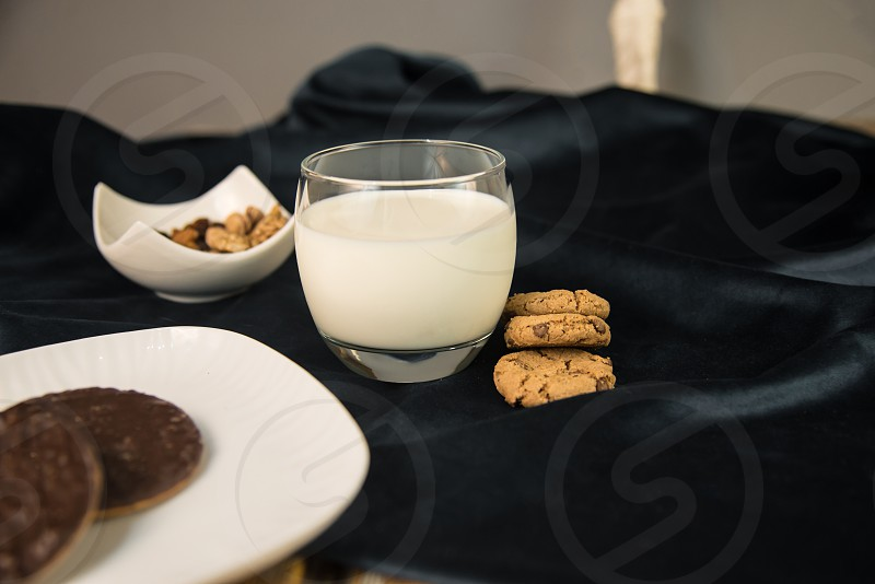 Cup of milk wish cookies and nuts  photo