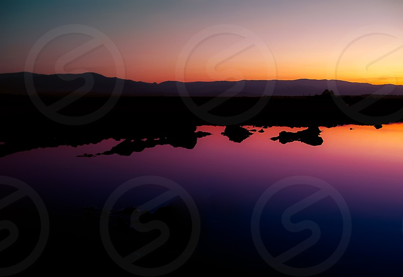 Sunset reflections in water photo