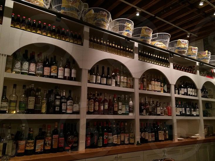 cabinet full of bottles photo