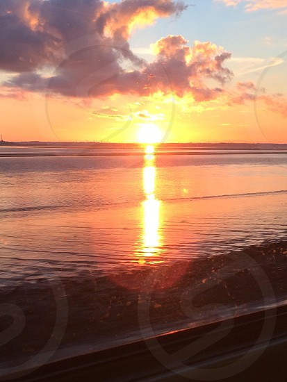 Sunset from the window of a train whilst leaving Hull photo