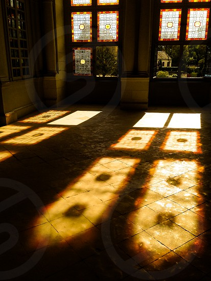 Shadows on the floor of medieval castle on sunny autumn day photo
