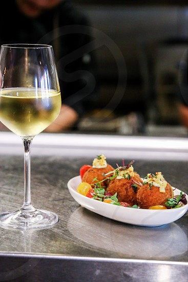 Tapas and chilled white wine photo