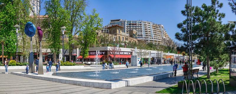 Odessa Ukraine - 04.22.2019. Walking alley of shops and restaurants in Arcadia resort in Odessa Ukraine on a sunny spring day photo