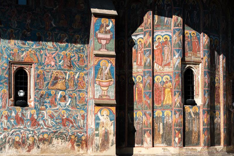 MOLDOVITA MOLDOVIA/ROMANIA - SEPTEMBER 18 : Frescos on the exterior of the Monastery in Moldovita in Moldovia Romania on September 18 2018 photo