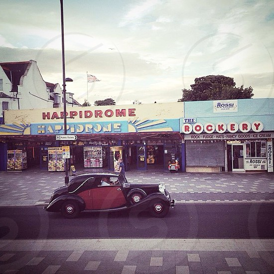 Sunday drive. Vintage motor vehicle driving along the famous Southend sea front.  photo